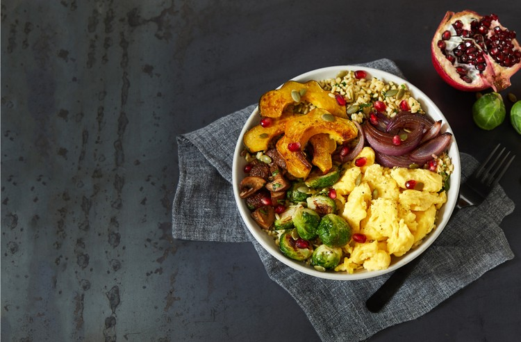 A bowl with JUST Egg, grains and roasted vegetables