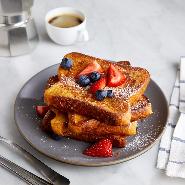 french toast topped with blueberries and strawberries on a plate