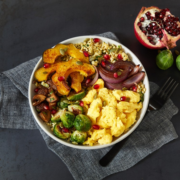 A bowl with eggs and other vegetables