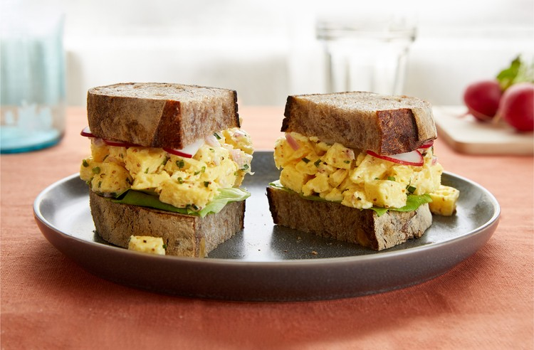JUST Egg salad sandwich cut in half on a plate