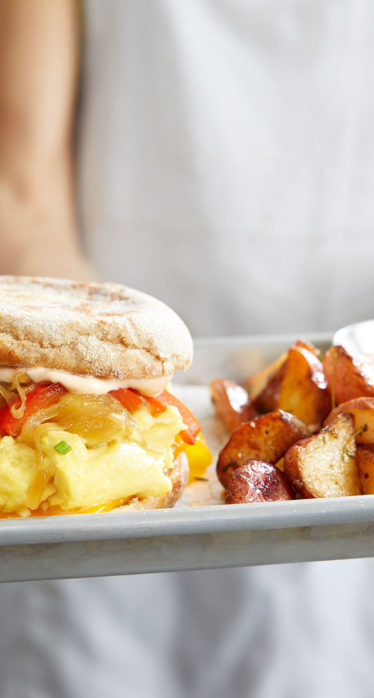 Egg sandwich with a side of potatoes
